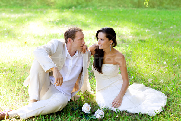 couple just married sitting in park grass Stock photo © lunamarina