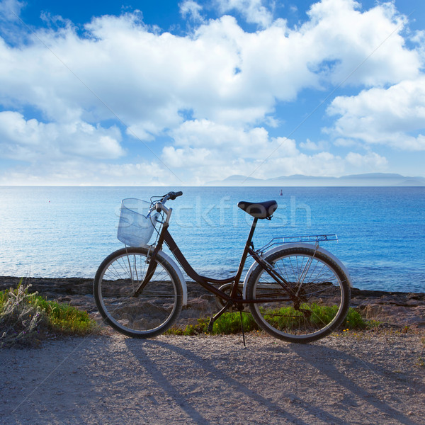 Stock photo: Bicycle in formentera beach with Ibiza sunset