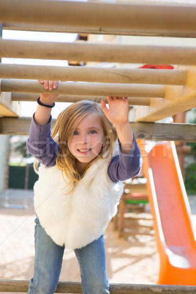 Gyerek lány játszik játszótér akasztás fa Stock fotó © lunamarina