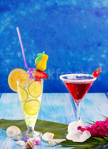Lemon Mojito and red Margarita cocktails in Caribbean blue wood Stock photo © lunamarina