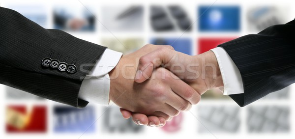 Tech tv video communication screen handshake Stock photo © lunamarina