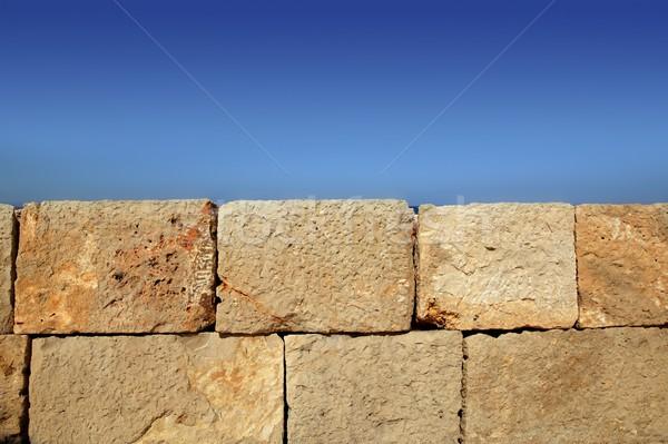 Big stone bricks masonry wall on port blue sky Stock photo © lunamarina