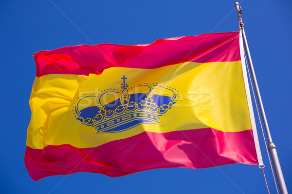 Spain red and yellow flaw waving on wind Stock photo © lunamarina