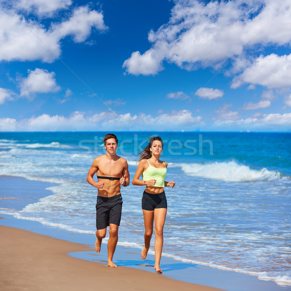 Couple young running in the beach in summer Stock photo © lunamarina