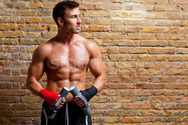 muscle boxer man with fist bandage and weights Stock photo © lunamarina