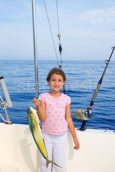 child girl fishing in boat with mahi mahi dorado fish catch Stock photo © lunamarina