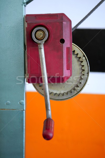 Hand lever winch in red over orange on car repair workshop Stock photo © lunamarina