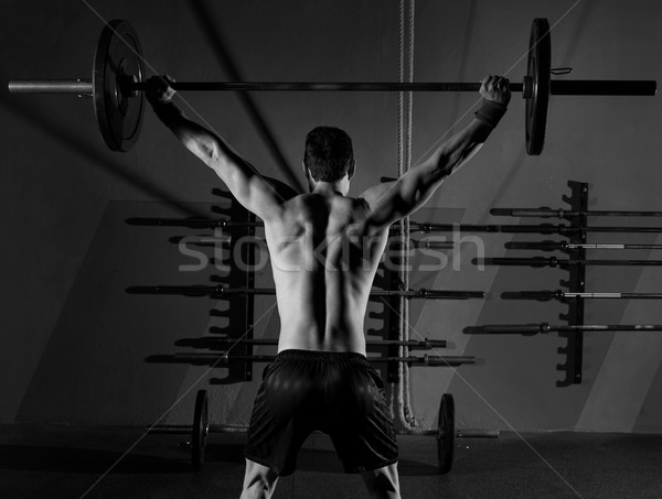 barbell weight lifting man rear view workout gym Stock photo © lunamarina