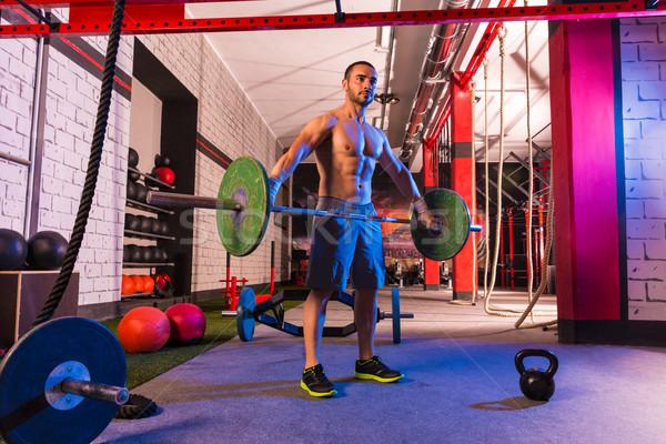 Súlyzó súlyemelés férfi edzés testmozgás tornaterem Stock fotó © lunamarina