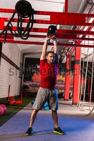 battling ropes girl at gym workout exercise Stock photo © lunamarina
