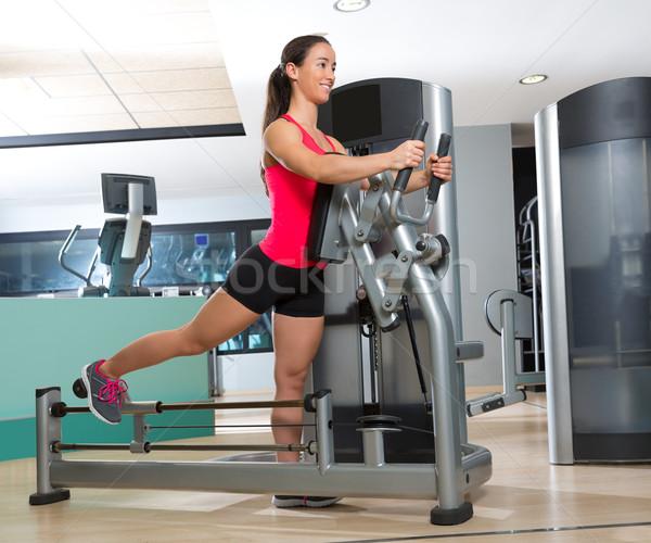 Gym glute exercise machine woman workout Stock photo © lunamarina