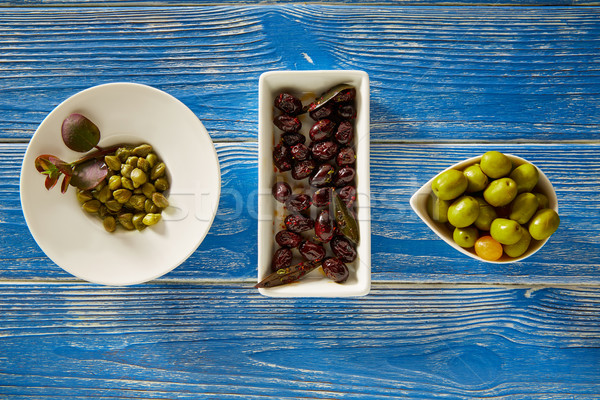 Pickles olives noires tapas bleu table en bois Photo stock © lunamarina