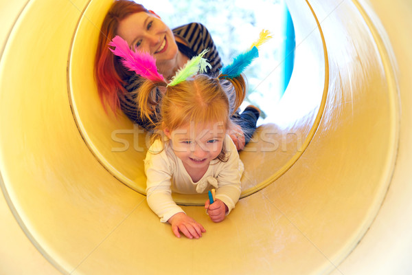 Kid girl and mother playing in the park slider Stock photo © lunamarina