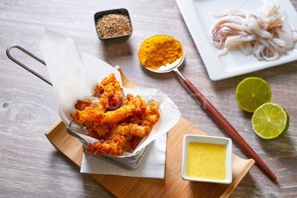 Fried breaded squid and curry sauce and lime Stock photo © lunamarina
