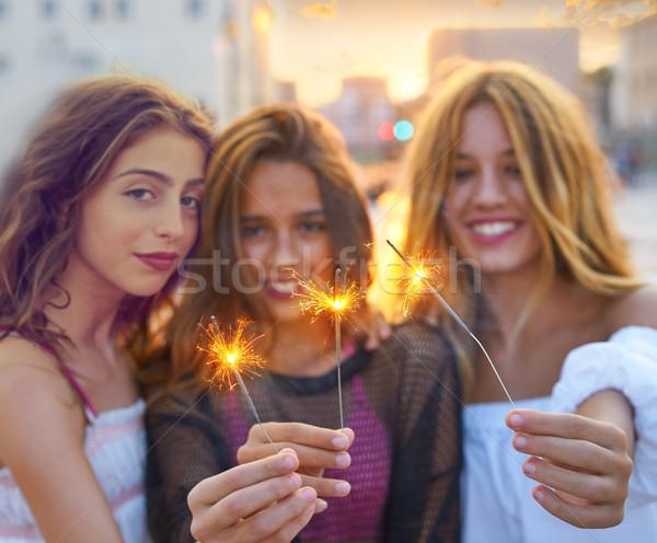 Best friends teen girls with sparklers Stock photo © lunamarina