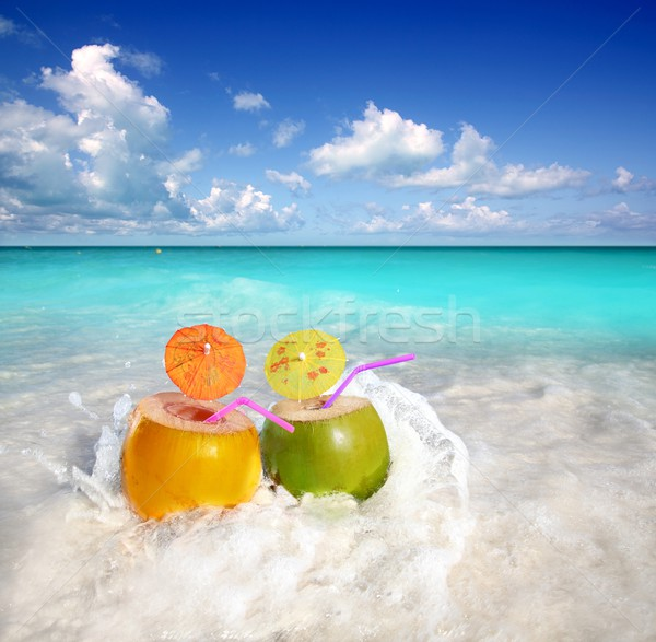 coconut cocktails juice in tropical beach water splash Stock photo © lunamarina