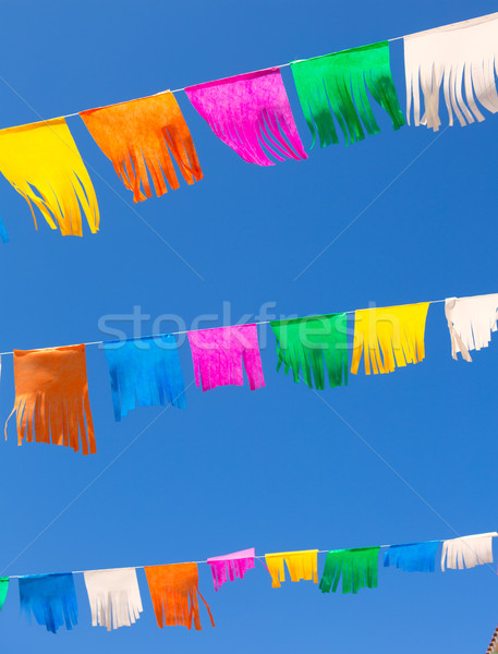 colorful tissue Paper fringe garland under blue sky Stock photo © lunamarina