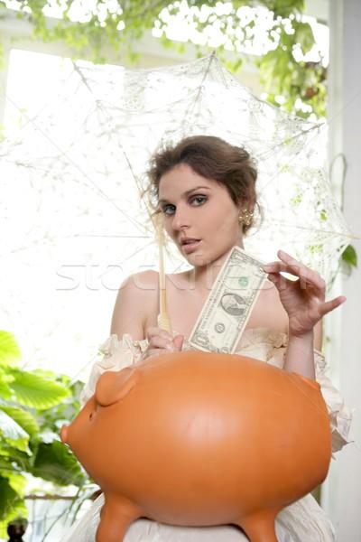 Old costume fashion woman and piggy bank Stock photo © lunamarina