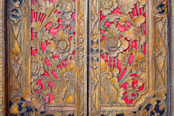 Indian inspired carved golden red wooden door Stock photo © lunamarina