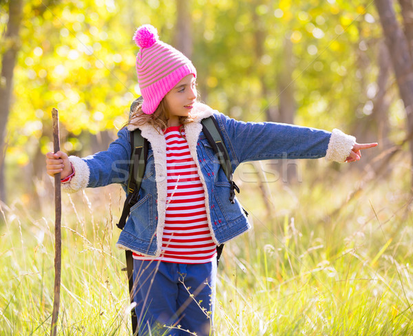 Hiking kid girl with backpack pointing finger in autum forest Stock photo © lunamarina