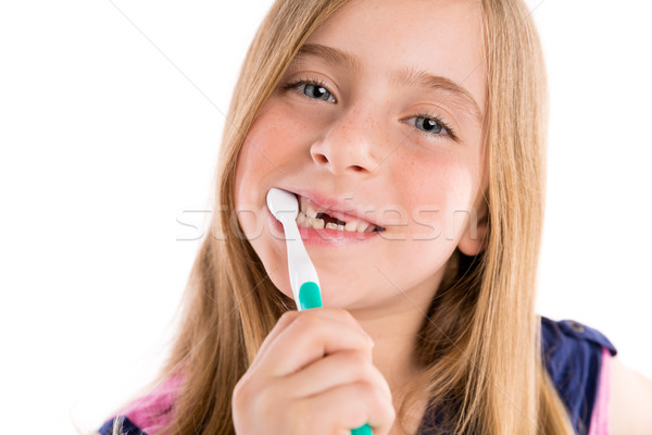 Blond kid indented girl cleaning teeth toothbrush Stock photo © lunamarina