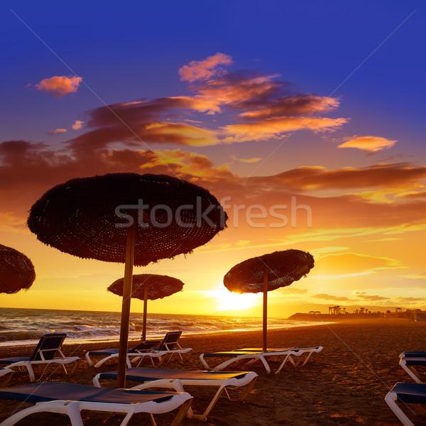 Pôr do sol praia Espanha céu nuvens paisagem Foto stock © lunamarina