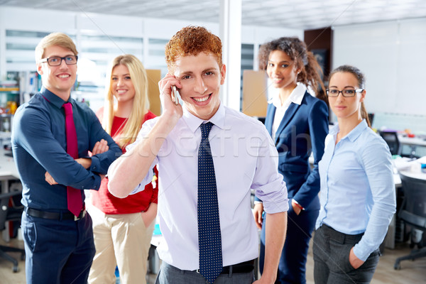 young executive talking phone in multi ethnic team Stock photo © lunamarina
