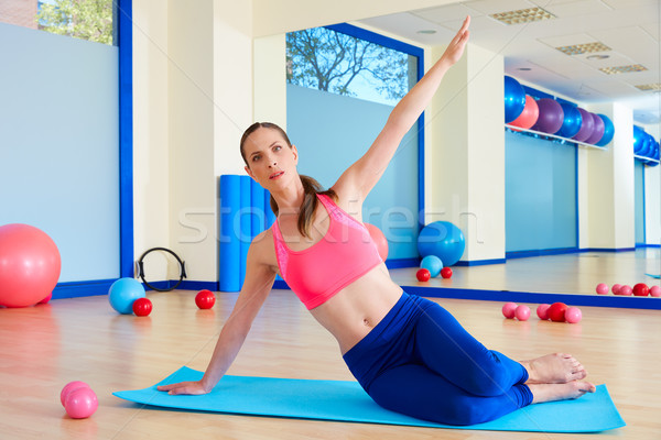 Pilates woman stretching exercise workout at gym indoor Stock photo © lunamarina