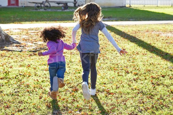Stock photo: Multi ethnic kid girls playing running in park