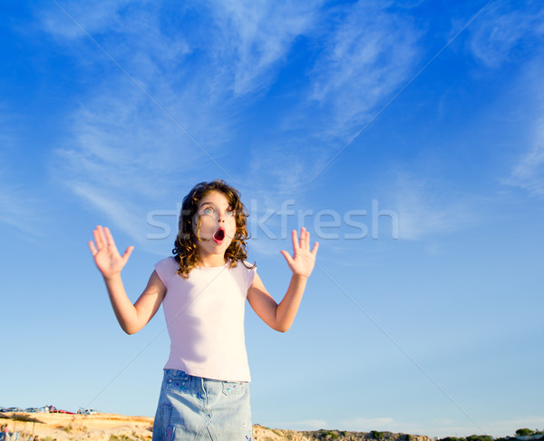 Girl open arms outdoor under blue sky Stock photo © lunamarina