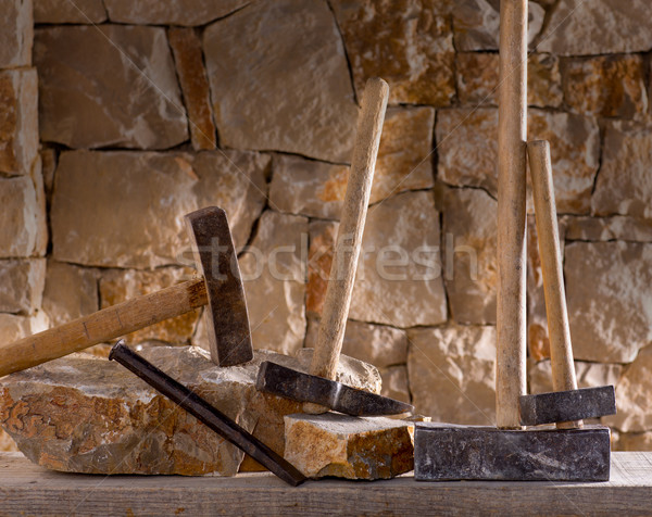 Hammer tools of stonecutter masonry work Stock photo © lunamarina