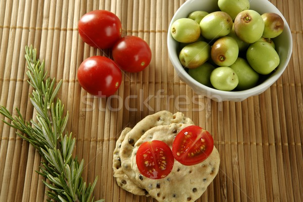 Sesame seeds biscuits with tomato Stock photo © lunamarina
