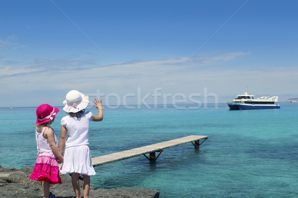 two girls tourist turquoise sea goodbye hand gesture Stock photo © lunamarina
