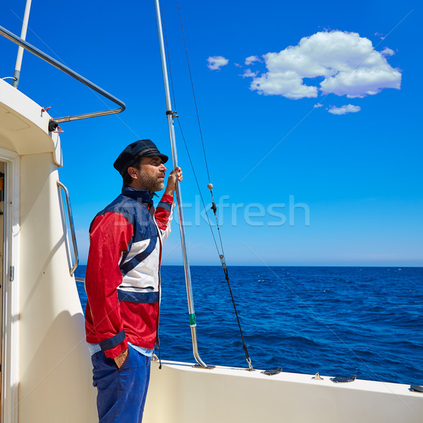 Beard sailor man sailing sea in a boat captain cap Stock photo © lunamarina