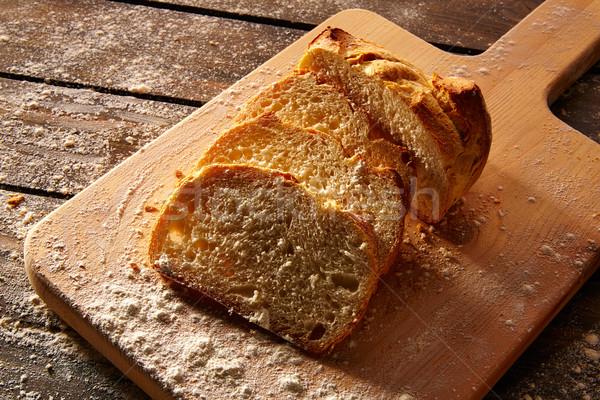 Bread sliced loaf on wooden board in rustic wood Stock photo © lunamarina