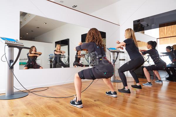 EMS electro stimulation women exercises Stock photo © lunamarina