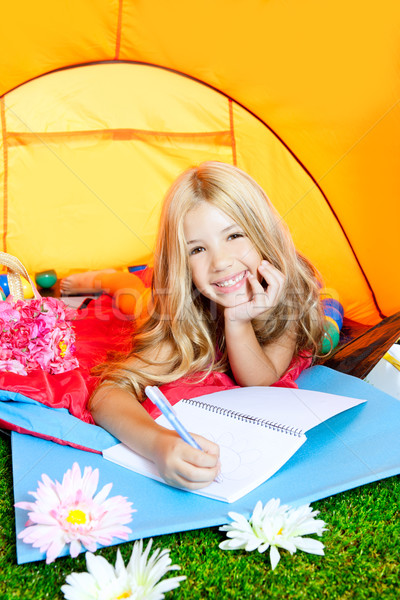 Stock photo: Children girl writing notebook in camping tent with flowers
