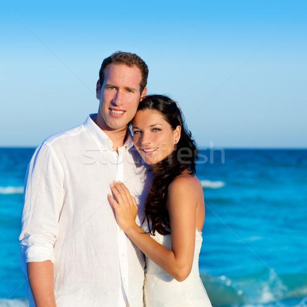 couple in love hug in blue sea vacation Stock photo © lunamarina