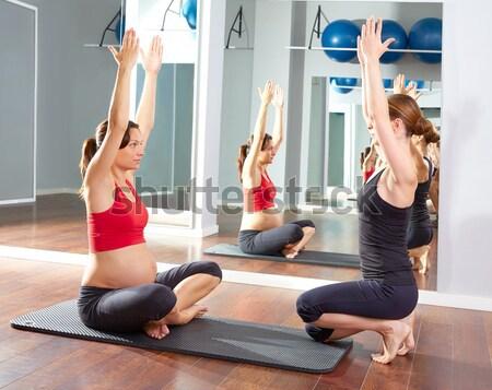Aerobics pilates gym women group and crosstrainer Stock photo © lunamarina