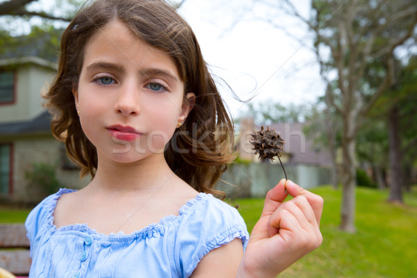 girl portrait with sweetgum spiked fruit on park Stock photo © lunamarina