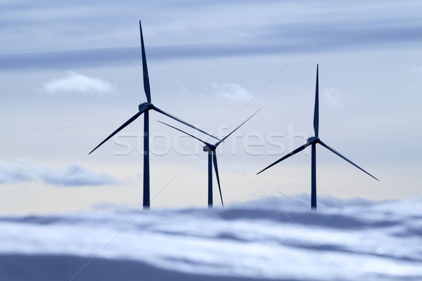 Stock photo: aerogenerator electric windmills snow mountain