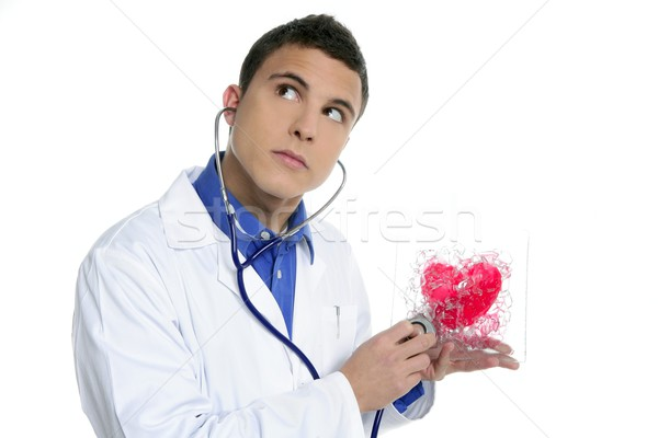Doctor test a red heart health, young man Stock photo © lunamarina