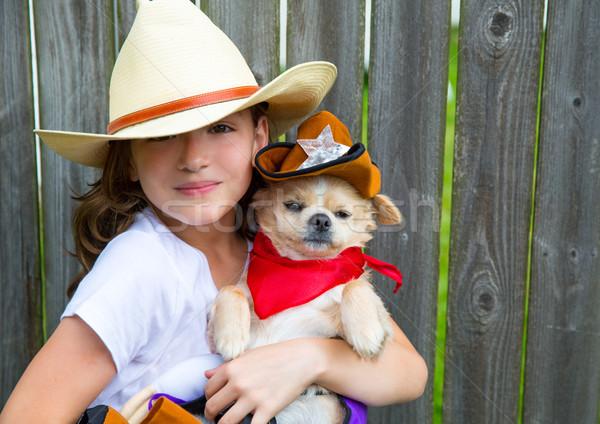 Gyönyörű cowboy gyerek lány tart sheriff Stock fotó © lunamarina