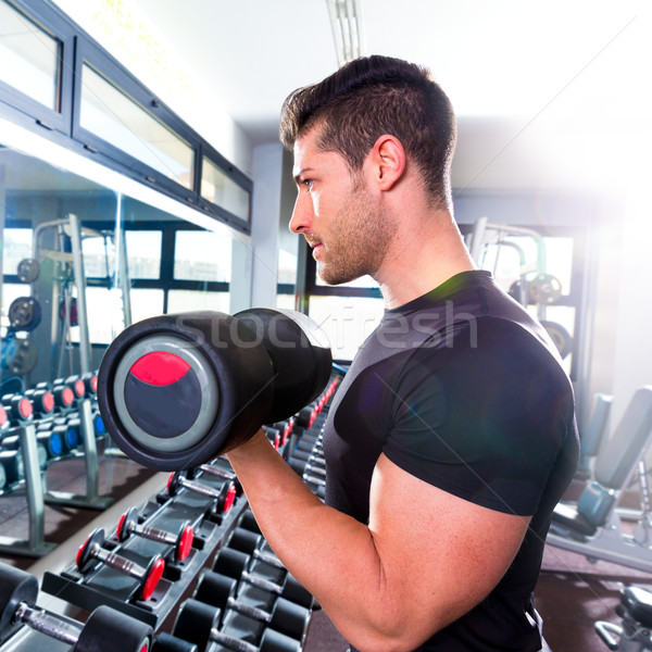 Dumbbell man at gym workout biceps fitness Stock photo © lunamarina