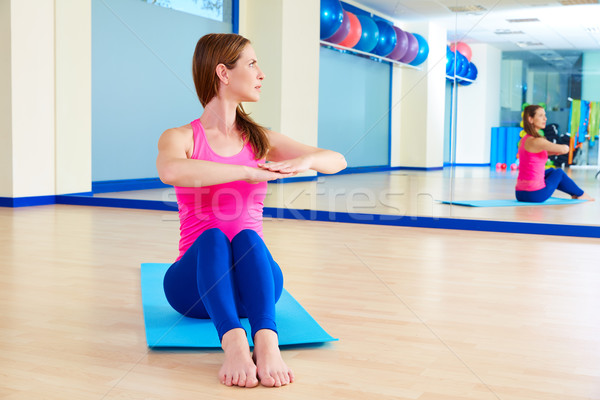 Pilates woman spine twist exercise workout at gym Stock photo © lunamarina