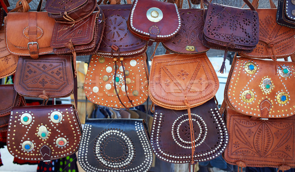 Moroccan leather goods bags in a row at market Stock photo © lunamarina