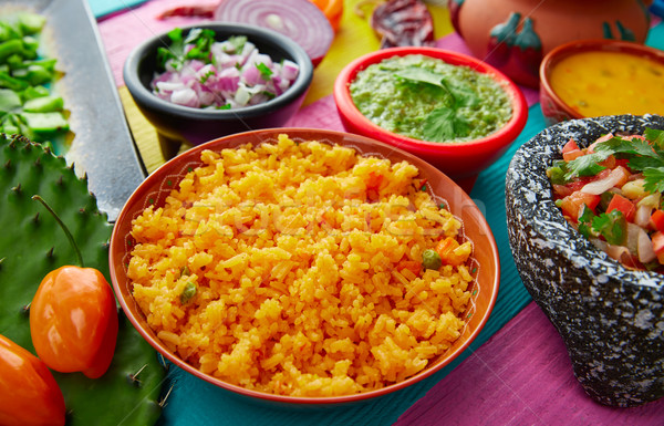 Mexican yellow rice with chilis and sauces Stock photo © lunamarina