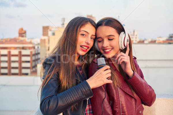 Best friends band girls singing karaoke outdoor Stock photo © lunamarina