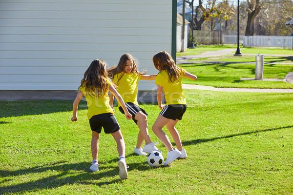 Friend girls teens playing football soccer in a park Stock photo © lunamarina