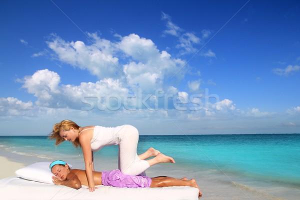Caribbean beach therapy shiatsu massage on knees Stock photo © lunamarina